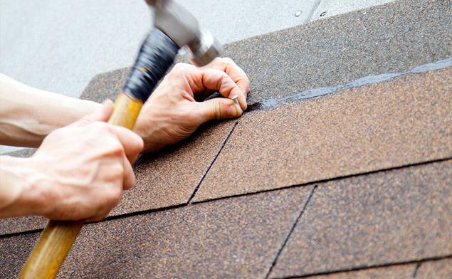 installing an asphalt shingle on a roof