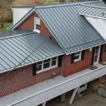roof with grey metal standing seam panels
